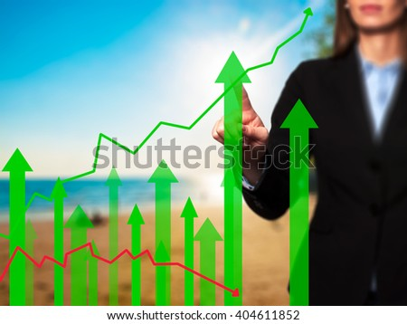 Sales Growth Graph - Businesswoman hand pressing button on touch screen interface. Business, technology, internet concept. Stock Photo