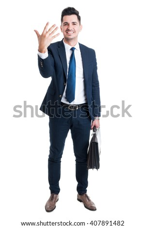 Sales man standing holding briefcase and showing number five while smiling isolated on white background - stock photo
