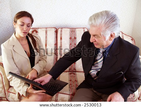Sales Manager checking the sales results with sales person - stock photo