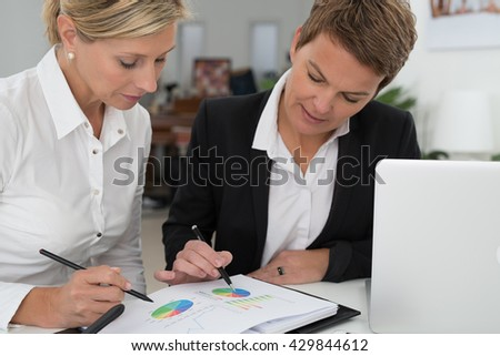 sales managers comparing charts
