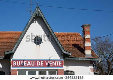Sales office sign on a old house under bue sky - stock photo