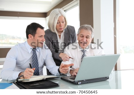 Sales people in work meeting - stock photo