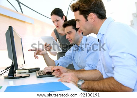 Sales people meeting in office - stock photo