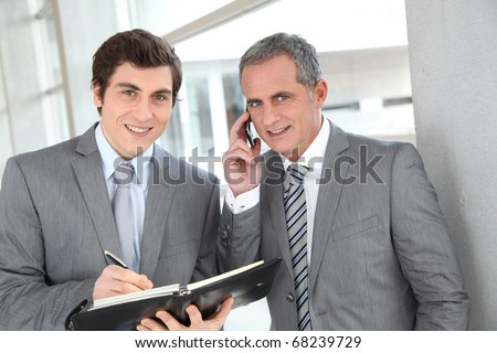 Sales people meeting in office building - stock photo