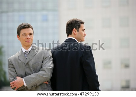 Sales people standing outside the office