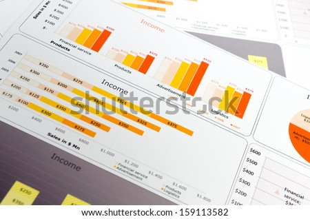 Sales Report in Statistics Graphs and Charts Colored - stock photo