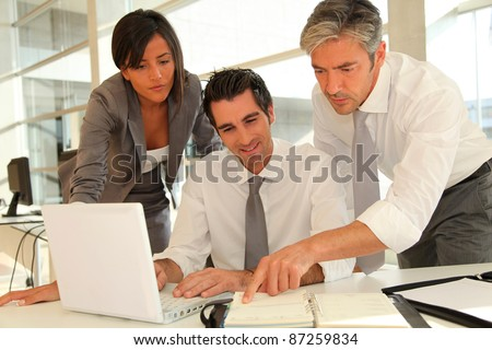 Sales team having business presentation in office - stock photo