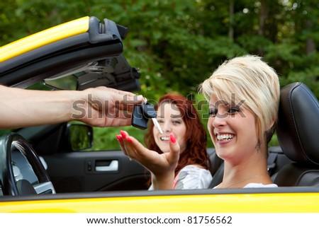 Salesman Giving Happy Customer New Car Keys - stock photo