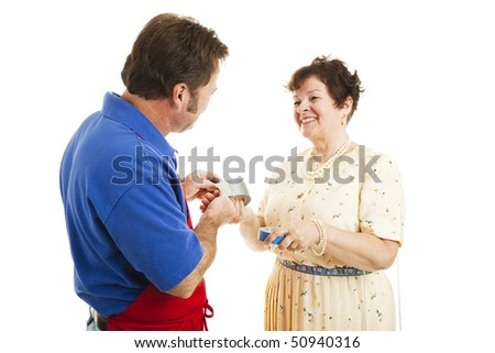 Salesman in a hardware store advises a woman on which tape is right for the job.  Isolated on white. - stock photo