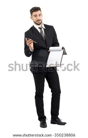 Salesman in suit giving contract and pencil looking at camera. Full body length portrait isolated over white studio background.