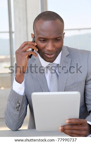 Salesman on business travel using electronic tablet - stock photo