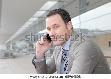 Salesman talking on the phone outside congress center