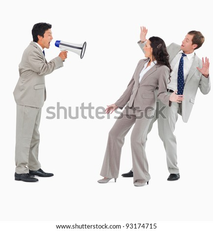 Salesman with megaphone shouting at colleagues against a white background - stock photo