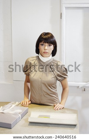Saleswoman in Boutique - stock photo