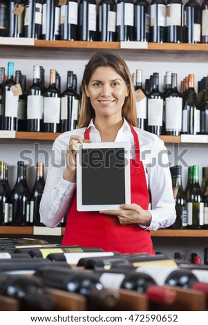 Saleswoman Showing Blank Digital Tablet In Wine Shop
