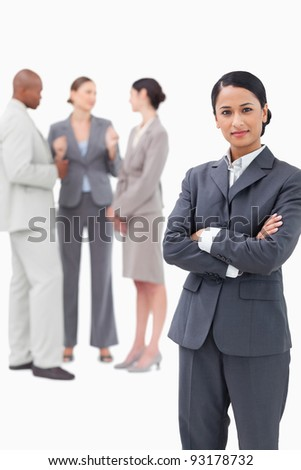 Saleswoman with negotiating trading partners behind her against a white background
