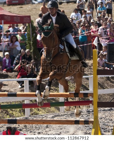 SALICEA, ROMANIA - SEPTEMBER 9: An unidentified competitor jumps with his horse at the Napoca Cup Sport Horse, September 9, 2012 in Salicea, Romania