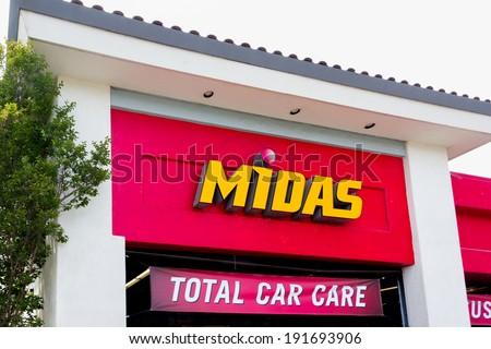 SALINAS, CA/USA - MAY 7, 2014:  Midas Automotive Service facility.  Midas, Inc. is a chain of automotive service centers headquartered in Itasca, Illinois. - stock photo