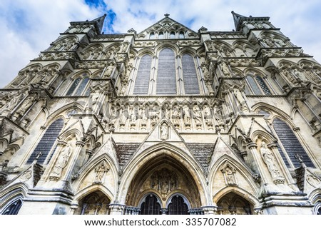 Salisbury, England - April 24 : Salisbury's Cathedral pictured on April 24, 2015 in Salisbury, England. Completed in 1258, the cathedral has the tallest church spire in the United Kingdom (404 ft).  - stock photo