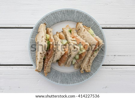 Salmon and cuecumber sandwiches - stock photo