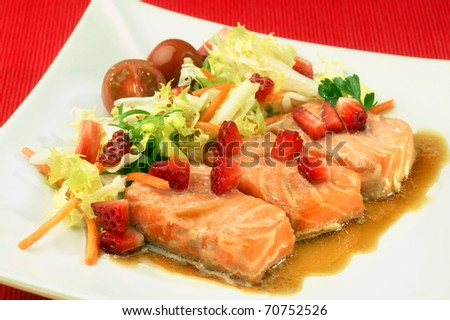 salmon and strawberry salad, tomatoes, lettuce and carrots
