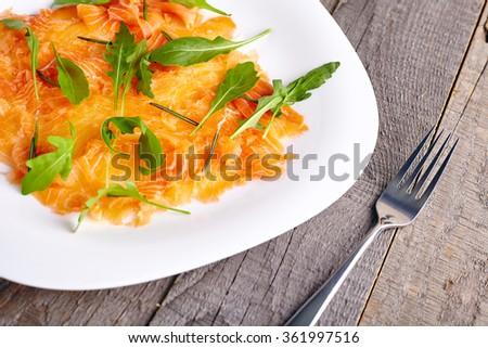 Salmon carpaccio close up - stock photo