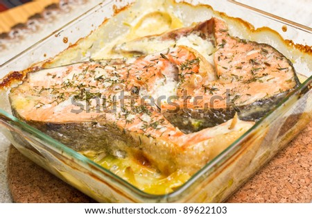 Salmon casserole with cream and leek - stock photo