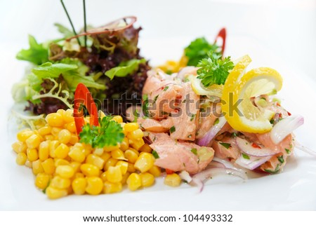 Salmon ceviche with corn and herbs close-up
