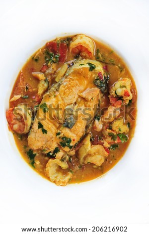 salmon curry with shrimps - stock photo