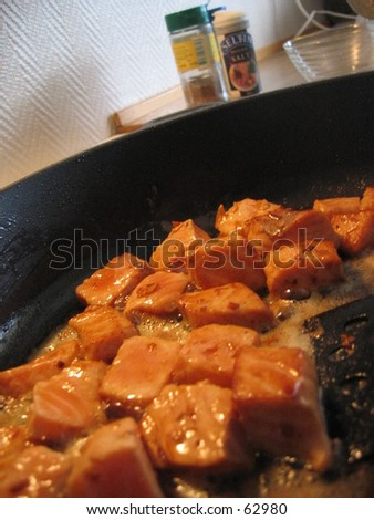 Salmon dish being prepared - stock photo