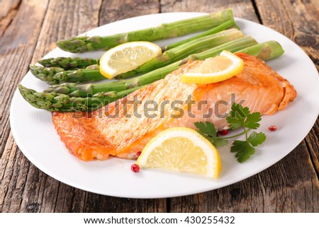 salmon fillet and asparagus - stock photo