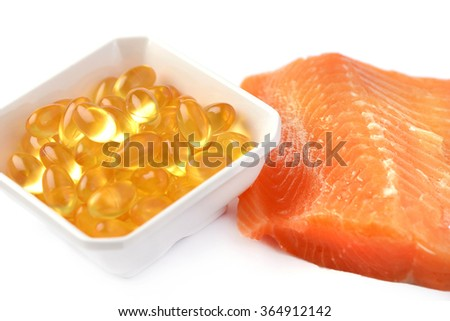 Salmon fillet slice Omega supplement food fish essential oil capsules - stock photo