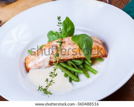 Salmon fillet with green beans - stock photo