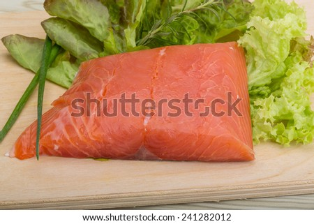 Salmon fillet with herbs on the board
