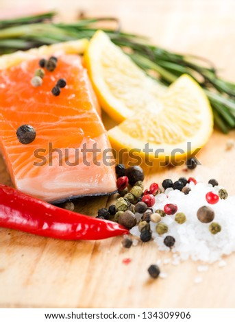Salmon fillet with rosemary and lemon - stock photo