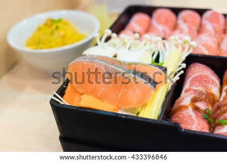Salmon fish and kurobuta pork slices and salmon fish on plates, for sukoyaki and yakiniku hot pot shabu, japanese food. ready to served, Shallow DOF - stock photo