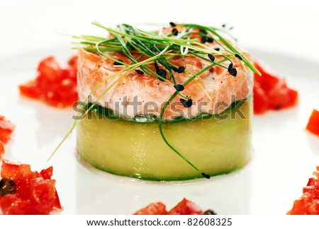 Salmon fish dish decorated on a white plate - stock photo