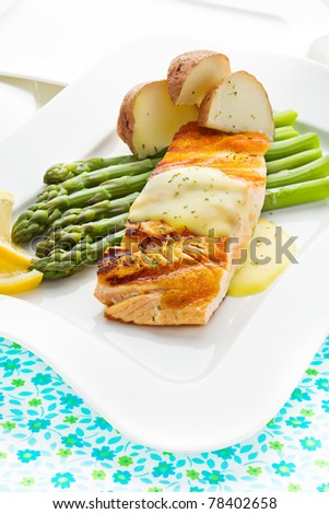 Salmon fish meal with potato and asparagus vegetable. - stock photo