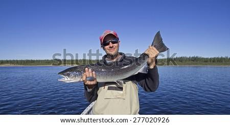Salmon fishing trophy - stock photo