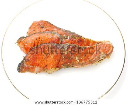 Salmon fried with spices. - stock photo
