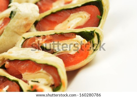 salmon in puff pastry on white dish