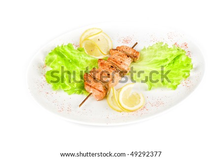 salmon kebab at plate isolated on a white background - stock photo