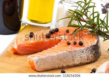 salmon on platter with rosemary, pepper and juniper