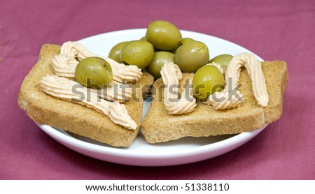 salmon pate canapes, on light purple background - stock photo