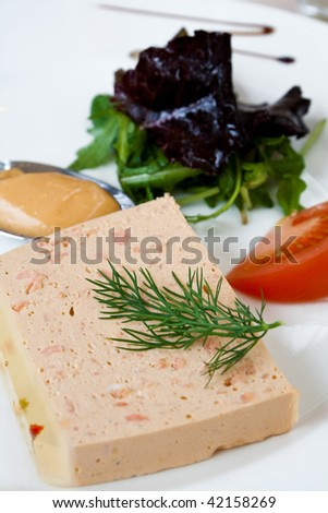 Salmon pate, green salad and sauce - stock photo
