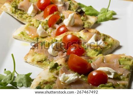 Salmon pizza - stock photo
