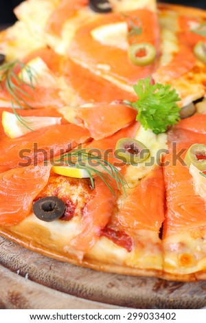 salmon Pizza is cut into ready to eat. - stock photo