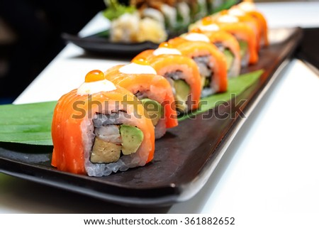 Salmon roll sushi with avocado , crab and vegetable - Healthy japanese restaurant - stock photo