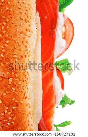 salmon sandwich on white with green salad and tomatoes - stock photo