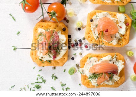 Salmon sandwich with cream cheese and crackers,selective focus  - stock photo